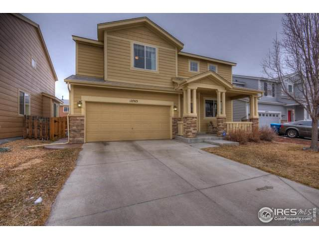 12763 E 105th Pl, Commerce City, CO 80022 (#904689) :: The Peak Properties Group