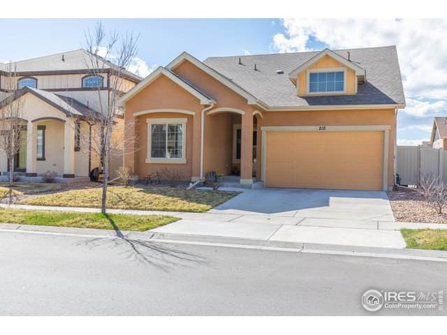 212 Indian Peaks Dr, Erie, CO 80516 (#908411) :: The Griffith Home Team