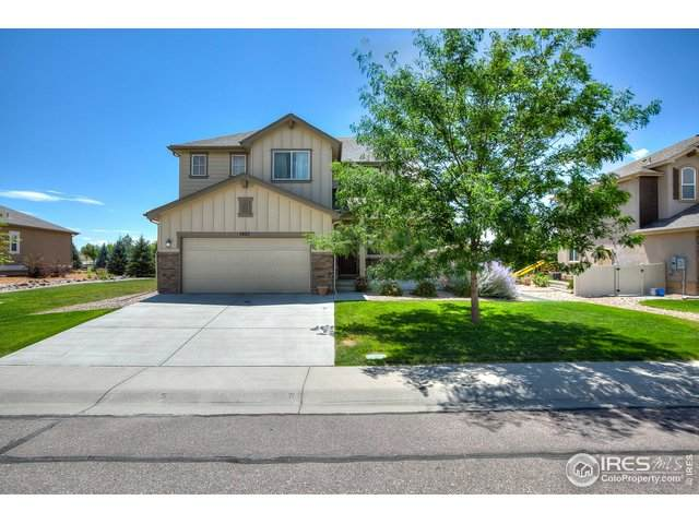 7407 Ladbroke Dr, Windsor, CO 80550 (#919838) :: The Margolis Team