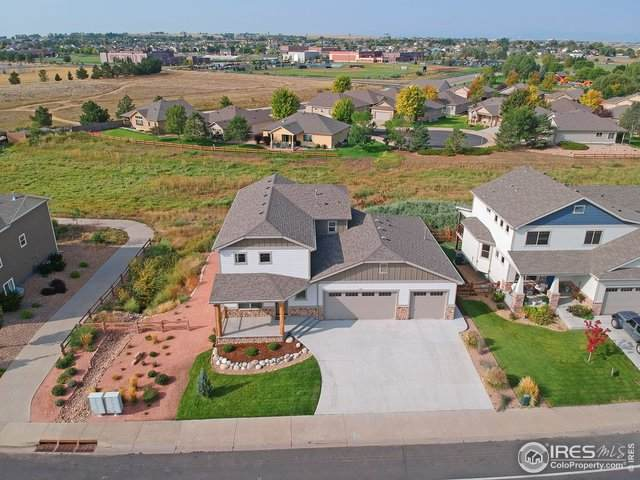1417 63rd Ave Ct, Greeley, CO 80634 (#924345) :: Compass Colorado Realty