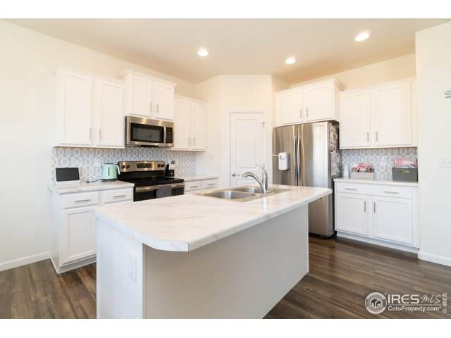 1060 Wagon Train Dr, Milliken, CO 80543 (MLS #934237) :: Kittle Real Estate