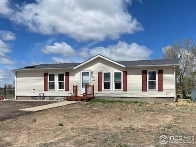307 Pine St, Wiggins, CO 80654 (#939760) :: Hudson Stonegate Team