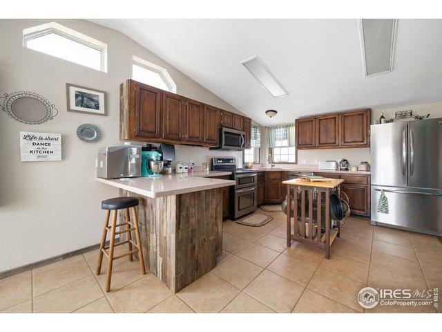 5041 County Road 73, Roggen, CO 80652 (#876911) :: The Peak Properties Group