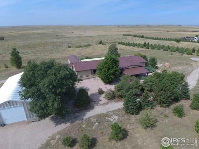 10695 Highway 52, Wiggins, CO 80654 (#899230) :: The Peak Properties Group