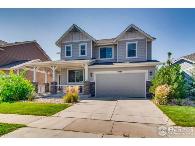 17048 W 87th Ave, Arvada, CO 80007 (#922312) :: Compass Colorado Realty