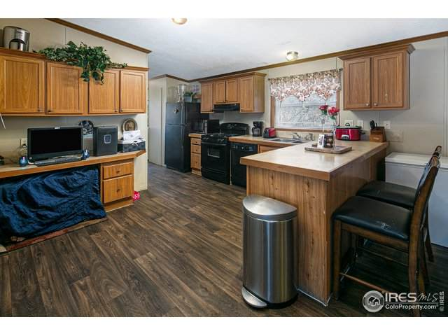 200 N 35th Ave #103, Greeley, CO 80634 (#4535) :: My Home Team