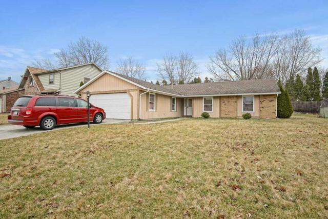 7121 Treverton Drive, Fort Wayne, IN 46816 (MLS #201812158) :: TEAM Tamara
