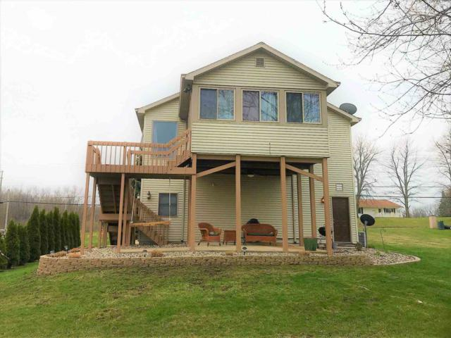 8476 E Hatchery Road, Syracuse, IN 46567 (MLS #201914307) :: Parker Team
