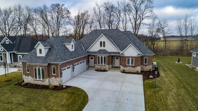 16161 Cobblestone Square Drive, Granger, IN 46530 (MLS #202001660) :: The ORR Home Selling Team