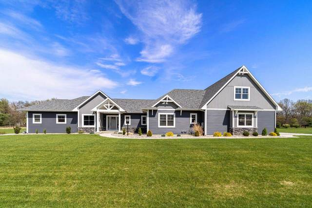 30260 Blackhawk Drive, Granger, IN 46530 (MLS #202115514) :: The Dauby Team