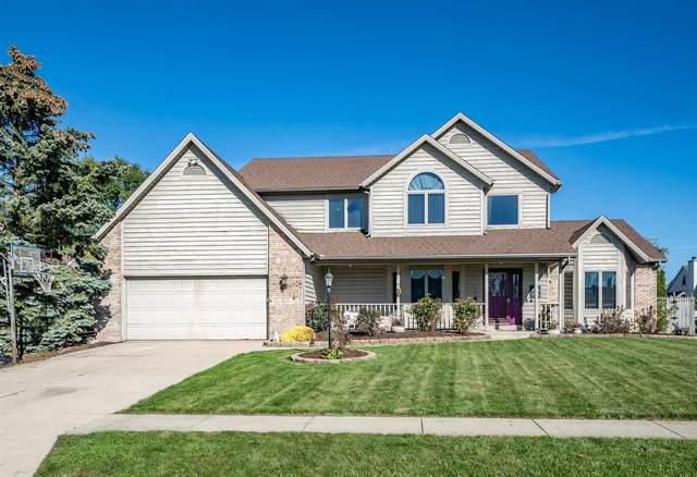 9830 Blue Mound Drive, Fort Wayne, IN 46804 (MLS #202144299) :: TEAM Tamara