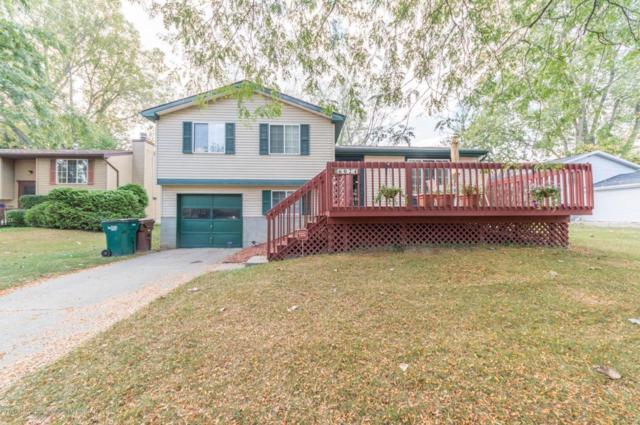 6024 Grenville Lane, Lansing, MI 48911 (MLS #220421) :: Real Home Pros