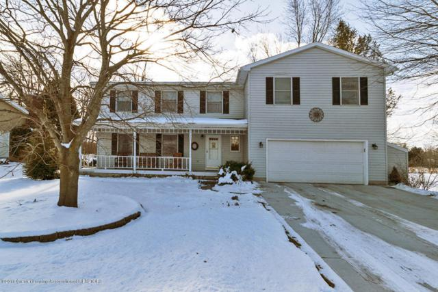 5700 Wood Valley Drive, Haslett, MI 48840 (MLS #223174) :: Real Home Pros
