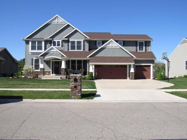 4855 E Hawk Hollow Drive, Bath, MI 48808 (MLS #224937) :: Real Home Pros