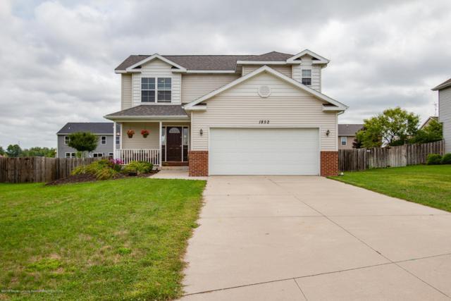 1852 Hollowbrook Drive, Holt, MI 48842 (MLS #229979) :: Real Home Pros