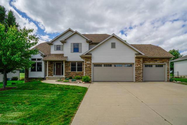 11739 Stone Bluff Drive, Grand Ledge, MI 48837 (MLS #230067) :: Real Home Pros