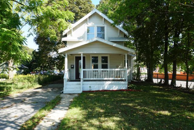 401 Riley Street, Lansing, MI 48910 (MLS #230355) :: Real Home Pros