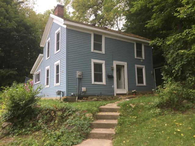 608 E Grand River Avenue, Portland, MI 48875 (MLS #230606) :: Real Home Pros