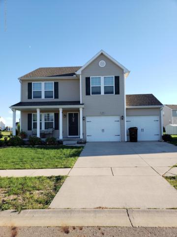 4205 Black Cherry Lane, Mason, MI 48854 (MLS #230695) :: Real Home Pros