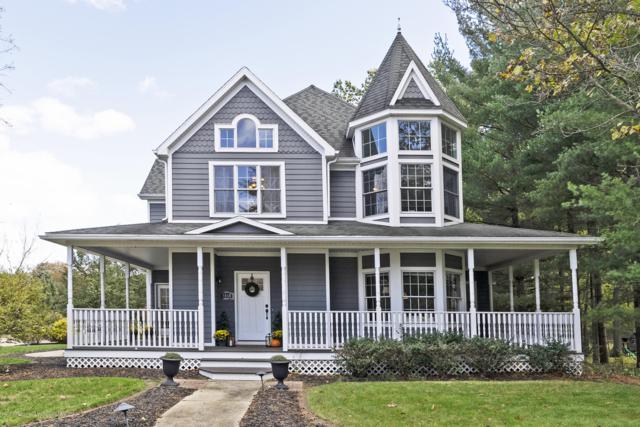 4060 Leeward Drive, Okemos, MI 48864 (MLS #231624) :: Real Home Pros