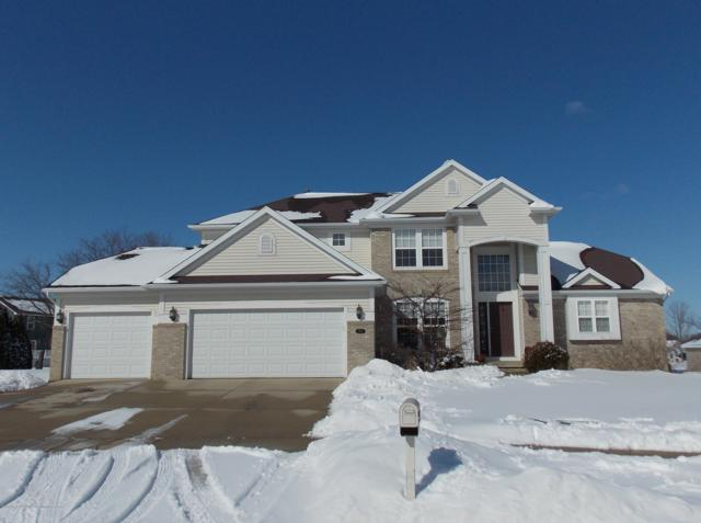 7467 Lonsdale Circle, Grand Ledge, MI 48837 (MLS #233943) :: Real Home Pros