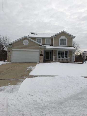 14813 Robinwood Drive, Lansing, MI 48906 (MLS #234207) :: Real Home Pros