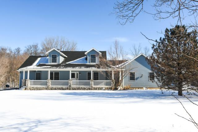 5692 Carlisle Highway, Charlotte, MI 48813 (MLS #234458) :: Real Home Pros