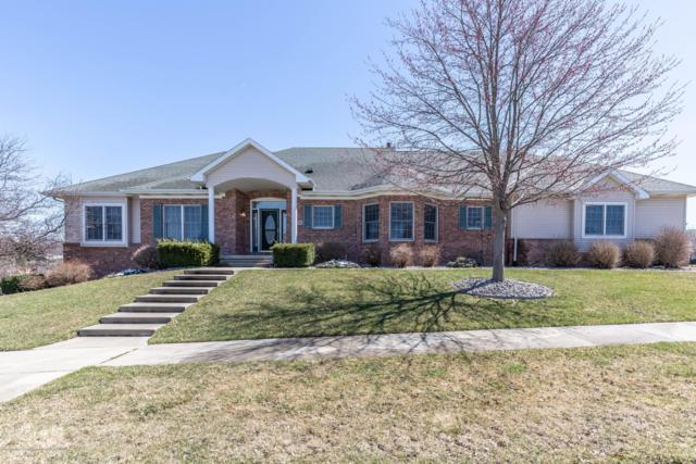 1112 Candela Lane, Grand Ledge, MI 48837 (MLS #235492) :: Real Home Pros