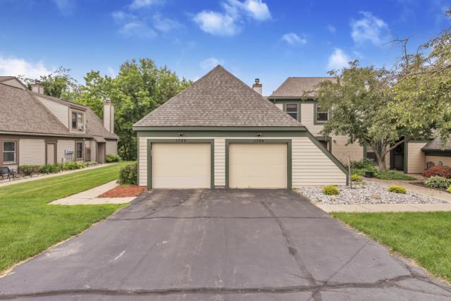 1786 Nemoke Trail #104, Haslett, MI 48840 (MLS #237741) :: Real Home Pros