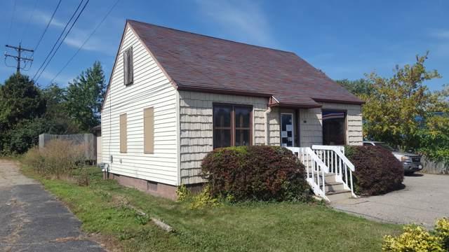 5214 S Pennsylvania Avenue, Lansing, MI 48911 (MLS #240997) :: Real Home Pros