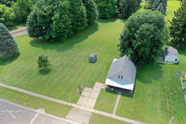 711 W Main Street, Grand Ledge, MI 48837 (MLS #241883) :: Real Home Pros