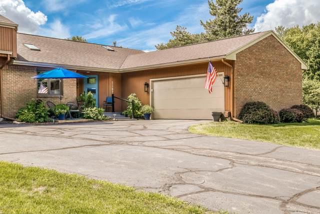 5307 E Hidden Lake Drive, East Lansing, MI 48823 (MLS #248494) :: Real Home Pros