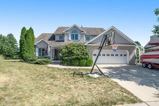 1580 Royal Crescent, Holt, MI 48842 (MLS #248993) :: Real Home Pros