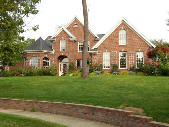 6397 Ridgepond Place, East Lansing, MI 48823 (MLS #224595) :: Real Home Pros