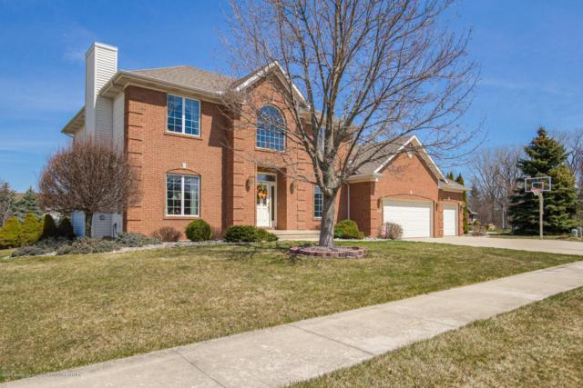 911 Woodbury Drive, Grand Ledge, MI 48837 (MLS #225354) :: Real Home Pros