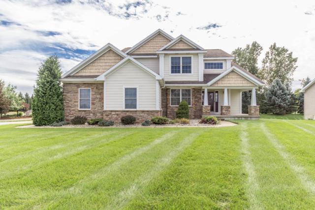 12960 Paradise Drive, Dewitt, MI 48820 (MLS #230383) :: Real Home Pros