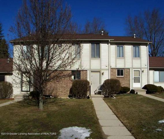 5952 Village Drive, Haslett, MI 48840 (MLS #234730) :: Real Home Pros