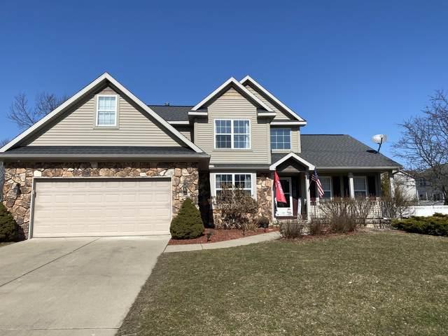 7291 Coneflower Court, Grand Ledge, MI 48837 (MLS #244381) :: Real Home Pros