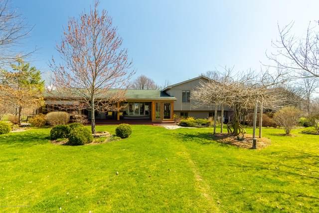 5010 N Williamston Road, Williamston, MI 48895 (MLS #246248) :: Real Home Pros