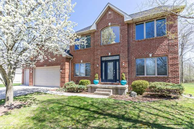 943 Abbey Road, East Lansing, MI 48823 (MLS #247135) :: Real Home Pros