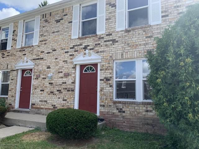1752 Maisonette Drive, Lansing, MI 48911 (MLS #248607) :: Real Home Pros