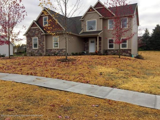 1202 Sunrise Drive, Grand Ledge, MI 48837 (MLS #222931) :: Real Home Pros