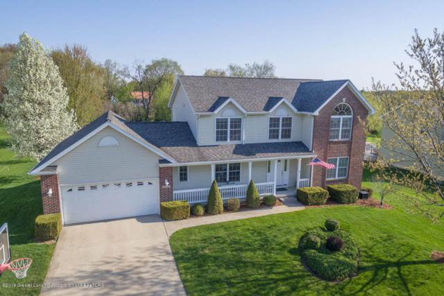 10141 River Rock Boulevard, Dimondale, MI 48821 (MLS #223530) :: Real Home Pros