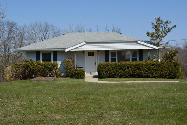9137 Frankfort Rd, Waddy, KY 40076 (#1498846) :: Team Panella