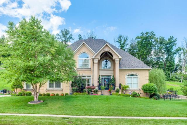 7711 Bella Woods Ct, Louisville, KY 40214 (#1509740) :: Team Panella