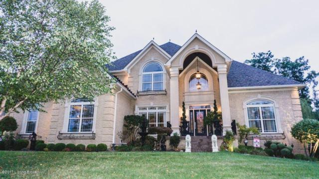 7711 Bella Woods Ct, Louisville, KY 40214 (#1486531) :: Team Panella