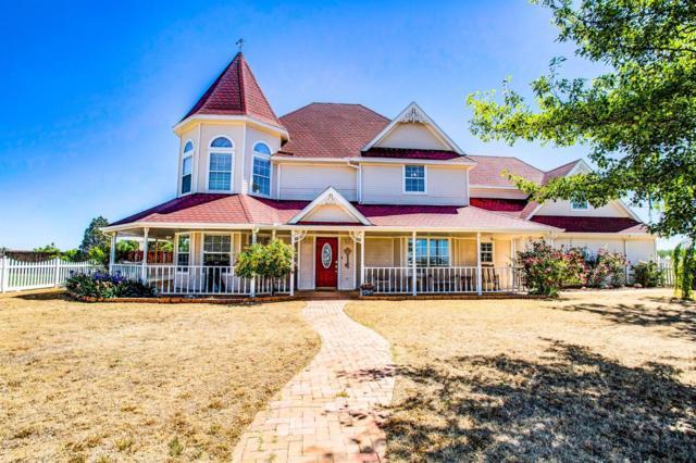 7611 Woodrow Road, Wolfforth, TX 79382 (MLS #201703007) :: Lyons Realty