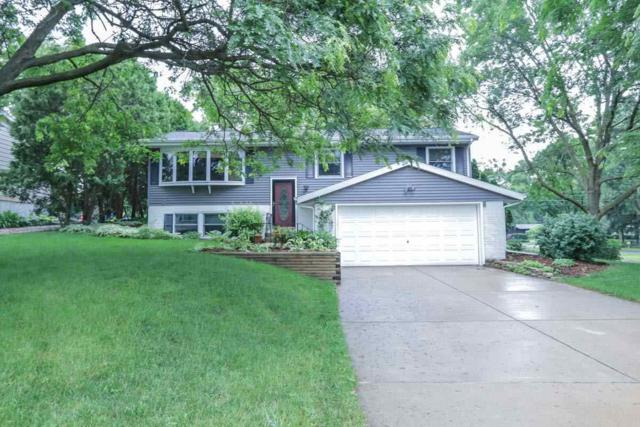 5202 Meadowood Dr, Fitchburg, WI 53711 (#1806798) :: Baker Realty Group, Inc.