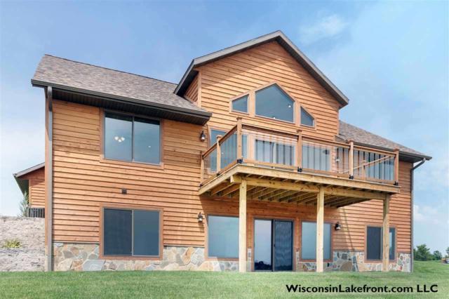 N8567 Lake Cabin Dr, Germantown, WI 53950 (#1854177) :: Nicole Charles & Associates, Inc.