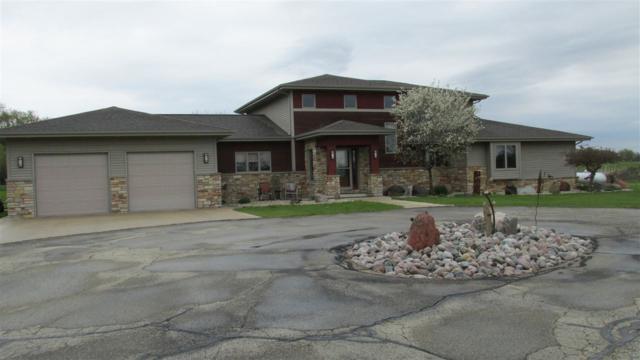 W7998 County Road B, Beaver Dam, WI 53916 (#1856843) :: Nicole Charles & Associates, Inc.